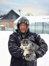 Portrait of a man holding a puppy outdoor in winter Royalty Free Stock Photos