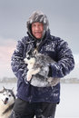 Portrait of a man holding a puppy outdoor in winter Stock Photography