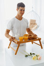 Portrait of man holding tray with breakfast young hadsome bed romantic healthy for his woman relationships care concept Stock Image