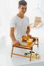 Portrait of man holding tray with breakfast young hadsome bed romantic healthy for his woman relationships care concept Royalty Free Stock Photo