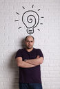 Portrait of a man with idea bulb above head. Royalty Free Stock Photo