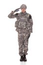 Portrait of man in military uniform saluting over white background Royalty Free Stock Images