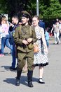Portrait of a man in military uniform and a woman in historic dress Royalty Free Stock Photo