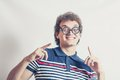 Portrait of a man with nerd glasses n studio fun toned image in head and shoulders shot gesturing Royalty Free Stock Images