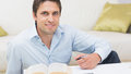 Portrait of a man with pen and book at home Royalty Free Stock Photo
