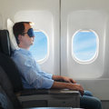 Portrait of man relaxing in the airplane Royalty Free Stock Photo