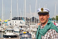 Portrait of a man in a sailor cap on the deck of a sailboat s Royalty Free Stock Photo
