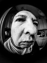 Portrait of a man self in chiaroscuro view fisheye lens Stock Images