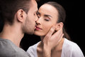 Portrait of man sensually kissing woman Royalty Free Stock Photo