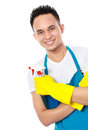 Portrait of man with sprayer ready to do housework isolated on white background Stock Photos