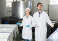 Portrait of man and woman dressed in lab coats are looking happy Royalty Free Stock Photo