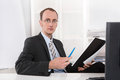 Portrait of a managing director at desk competent and capable young manager working as Royalty Free Stock Images