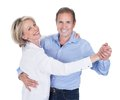 Portrait of mature couple dancing happy isolated over white background Royalty Free Stock Images