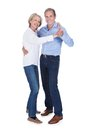 Portrait of mature couple dancing happy isolated over white background Stock Photography