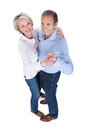 Portrait of mature couple dancing happy isolated over white background Stock Images