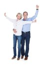 Portrait of mature couple enjoying success happy lovely isolated over white background Stock Photos