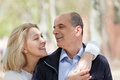 Portrait of mature couple happy smiling senior hugging outdoor Stock Photo