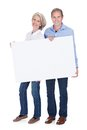 Portrait of mature couple holding placard happy blank isolated over white background Stock Photos