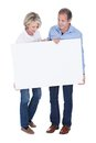 Portrait of mature couple holding placard happy blank isolated over white background Stock Photo