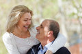 Portrait of mature couple smiling senior looking to each other outdoor Royalty Free Stock Image