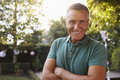 Portrait Of Mature Man In Back Yard Garden Royalty Free Stock Photo