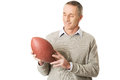 Portrait of mature man holding a rugby ball Stock Images