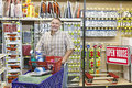 Portrait of a mature man with shopping cart in hardware store Stock Photo