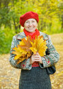 Portrait of mature woman in autumn park Royalty Free Stock Photos