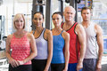 Portrait Of Men And Women At The Gym Royalty Free Stock Images