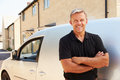 Portrait of middle aged tradesman standing by his van Royalty Free Stock Photo