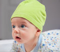 Portrait of months baby boy studio a happy old with green hat Stock Photo