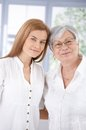 Portrait of mother and adult daughter smiling senior attractive hugging each other Stock Images