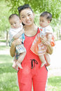 Portrait of mother and babies an asian is holding similing Royalty Free Stock Photos