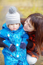 Portrait of mother with baby boy in autumn park age year Royalty Free Stock Photography