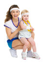 Portrait of mother and baby in tennis clothes with medal isolated on white Stock Photo