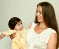 Portrait of mother and baby on white, yellow toned Royalty Free Stock Photo