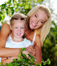 Portrait of  mother and daughter outdoors Royalty Free Stock Images