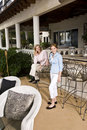 Portrait of mother and daughter on patio Royalty Free Stock Photo
