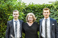Portrait of mother with her two adolescent sons dressed in suit tie Stock Images