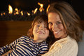 Portrait mother and son by firelight Royalty Free Stock Photo