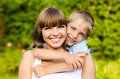 Portrait of mother and son happy laughing together outdoors Stock Photo