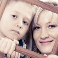 Portrait of mother and son holding photo frame Royalty Free Stock Photo