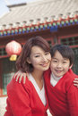 Portrait of mother and son outside traditional Chinese building Royalty Free Stock Photo