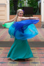 Portrait in motion slim blonde a bright evening gown Stock Photo