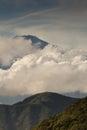 Portrait of mount Fuji summit peeking through clouds. Royalty Free Stock Photo