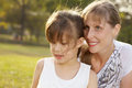 Portrait mum with daughter d lifestyle in funny pastime at the park outdoor Royalty Free Stock Image