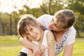 Portrait mum with daughter lifestyle in funny pastime at the park outdoor Royalty Free Stock Photos