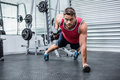 Portrait of muscular man using dumbbells in crossfit gym Royalty Free Stock Images