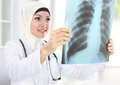 Portrait of muslim asian female medical doctor looking at xray Royalty Free Stock Photography