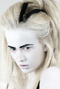 Portrait of mysterious albino woman with black eyebrows Stock Photo
